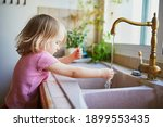 Adorable Toddler Girl Washing...