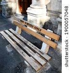 Small photo of Non whites only - old bench with an inscription left as memory of apartheid, racism and segregation. Non Whites; Only; street; Cape Town; Africa