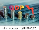 Small photo of GDP downfall concept, GDP growth slow down illustration with Indian map and down arrow, rupee downfall concept abstract background