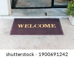 Welcome Mat In Shop Front Of...