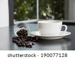 hot coffee cup and beans in... | Shutterstock . vector #190077128