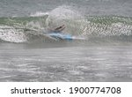 A Surfer Wipes Out And Is...