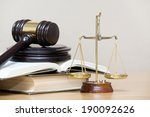 wooden gavel and books on
