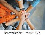 closeup of stack of hands.... | Shutterstock . vector #190131125