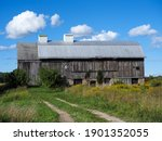 Tracks Lead To An Old Barn In...
