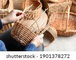 Woman Weaving Wicker Basket...