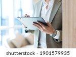 businessman in brown suit hand... | Shutterstock . vector #1901579935