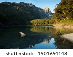 Mountains reflected in the clear waters of Lake Mackenzie, Routeburn Track, New Zealand