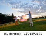 Couple Holding Us Flag And...