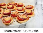 small pizzas on baking paper... | Shutterstock . vector #190210505
