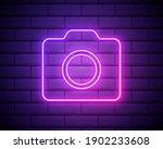 neon photo camera sign....