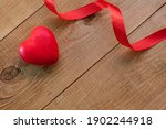 Red Heart And Ribbon On A...
