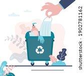 hand puts medical mask in trash ... | Shutterstock .eps vector #1902781162