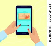 hands holding a smartphone.... | Shutterstock .eps vector #1902924265