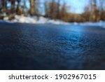 Frozen Blue Puddle Of Water In...