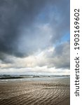Small photo of Dramatic blue sky with glowing cumulus clouds above the Baltic sea before sunset. View from a sandy shore. Autumn, early winter in Europe. Idyllic seascape. Fickle weather, climate change, ecology