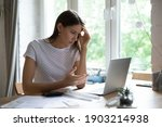 Small photo of Went into debt. Annoyed young lady look on pc screen calculate too big sum of tax utility bills mortgage loan payment. Confused female self employed enterpreneur miss term to pay tax receive penalty