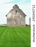 old gray barn and mowed lawn... | Shutterstock . vector #190345712