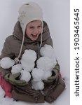 Happy Child Holding Snowballs...
