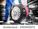 Car Mechanic Working In Garage...