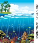 Coral reef with underwater creatures and green island with palm on a blue sky.