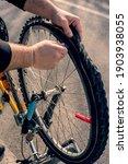 Man Repairs Punctured Bicycle...