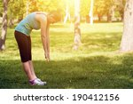 woman warming up before running | Shutterstock . vector #190412156