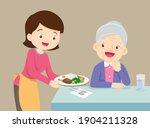 woman serving food to elderly... | Shutterstock .eps vector #1904211328