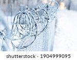 Barbed Wire Wrapped In White...