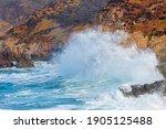Giant Waves Hitting Rocks On A...