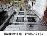 Old Broken Wooden Bridge With...