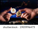 Business Men Holding Bitcoin...
