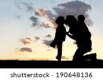 The Silhouette Of A Mother And...
