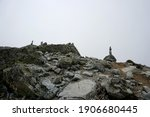 Stones stacked on top of each other in a pillar. Against the white cloud backdrop.Stone piles on top of each other, Slovakia. High Tatras national park