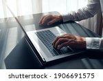 close up of man hands working... | Shutterstock . vector #1906691575