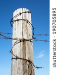 Barbed Wire Fence Post Against...