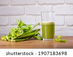 Small photo of Healthy Celery diet for the treatment of incurable mysterious diseases. Fresh celery juice squeezed out on a juicer.drink, vegetable juice, studio shot