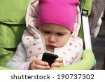 baby with mobile phone. | Shutterstock . vector #190737302