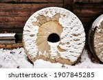 Millstones Leaning Against Old...