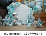 Arch of blue balloons for boy...