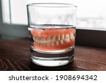 A Denture In A Glass Of Water....