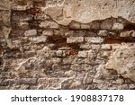Old Brick And Plaster Wall...