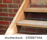 wooden stairs on brick wall | Shutterstock . vector #190887446