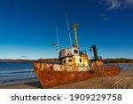 A Wrecked Ship On A Sandy Beach ...