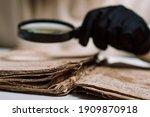 Historian Scientist In Gloves...
