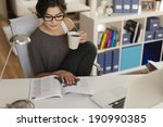 attractive woman reading... | Shutterstock . vector #190990385