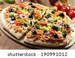 pizza vegetarian on plate | Shutterstock . vector #190991012