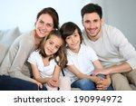 happy family sitting together... | Shutterstock . vector #190994972