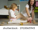 mother and daughter playing... | Shutterstock . vector #1910065945