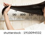 The Woman Is Measuring The...